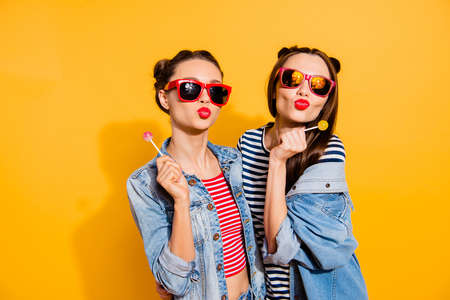 two young women with lollipops