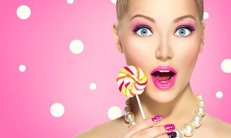 girl holding lolipop